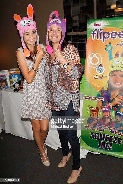 Actress Bailee Madison and mother Patricia Riley pose with Flipeez At KIIS FM PreTeen Choice Awards Gifting Suite on August 9 2013 in Los Angeles...