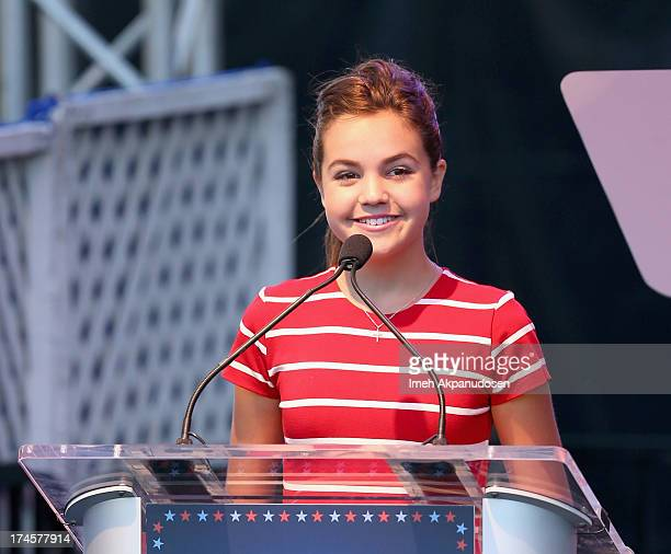 Actress Bailee Madison speaks on stage at Variety's Power of Youth presented by Hasbro Inc and generationOn at Universal Studios Backlot on July 27...