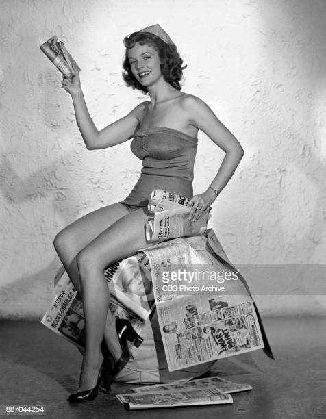 Actress Barbara Britton in cheesecake pose with a newspaper She portrays Mrs Pamela North on the CBS radio and television program Mr and Mrs North...