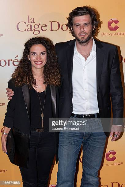 """Actress Barbara Cabrita and actor Lannick Gautry poses during the premiere of the movie """"La Cage Doree"""" at Cinema Gaumont Marignan on April 15, 2013..."""