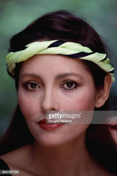 Actress Barbara Carrera in Neon Green Sweatband