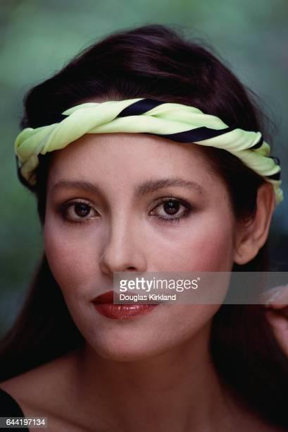 Actress Barbara Carrera in Neon Green Sweatband