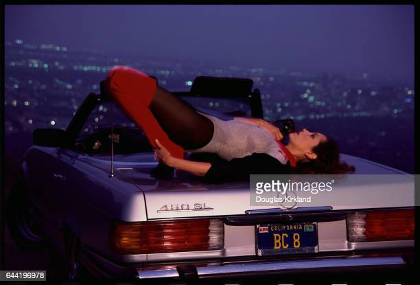 Actress Barbara Carrera Reclining on MercedesBenz