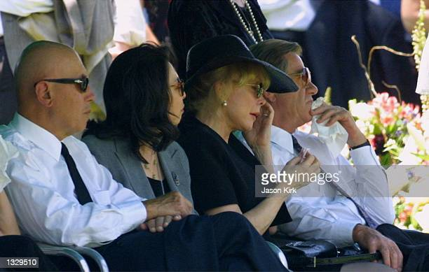 Actress Barbara Eden 2nd right wipes away tears during the funeral for her son Matthew Ansara July 2 2001 in Hollywood CA Matthew Michael Ansara was...