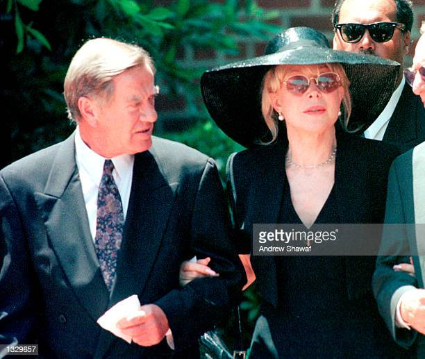 Actress Barbara Eden and her husband Jon Eicholtz left leave the funeral service at the Forest Lawn Cemetery for her son Matthew Ansara July 2 2001...