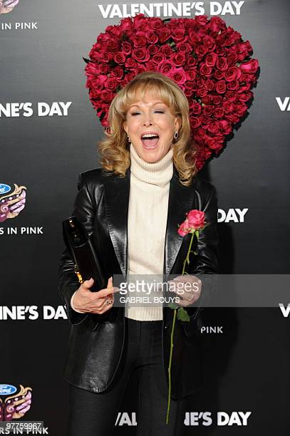Actress Barbara Eden holds a flower as she arrives at the Los Angeles Premiere for the Valentine's Day film at the Grauman's Chinese Theatre in...