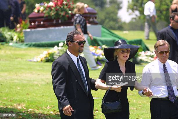 Actress Barbara Eden is helped by her husband Jon Eicholtz right and a friend after the funeral for Eden''s son Matthew Ansara July 2 2001 in...