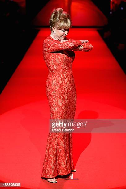 Actress Barbara Eden walks the runway at the Go Red For Women Red Dress Collection 2015 presented by Macy's fashion show during MercedesBenz Fashion...