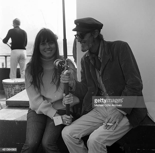 Actress Barbara Hershey sits with Earl Leaf at a pier in Los Angeles California