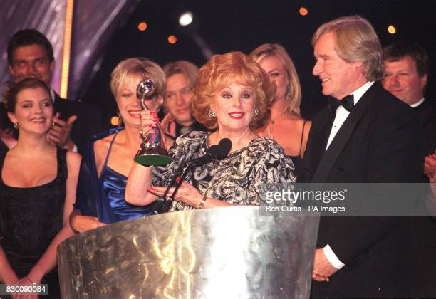Actress Barbara Knox who plays Rita in television programme 'Coronation Street' collects the award for Most Popular Serial Drama accompanied by Bill...