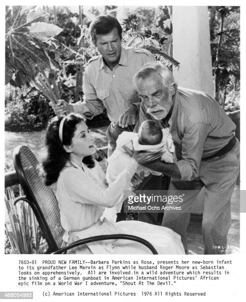 Actress Barbara Parkins and actors Lee Marvin and Roger Moore on set of the movie Shout at the Devil circa 1976
