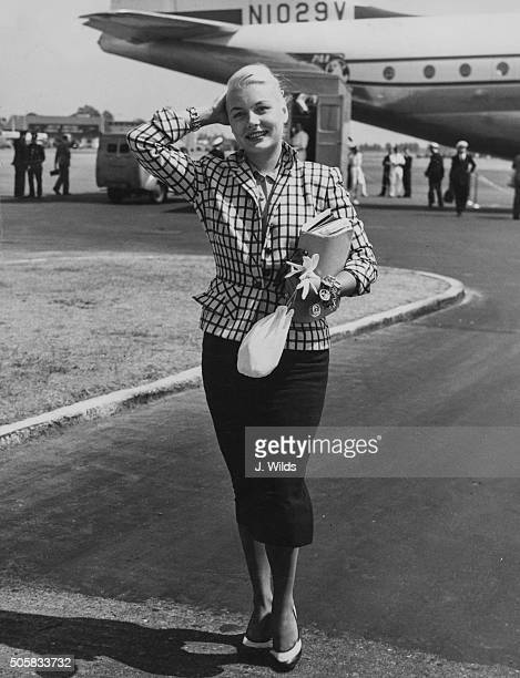 Actress Barbara Payton arriving to start filming 'Foursided Triangle' in Britain pictured on her arrival at London Airport July 24th 1952
