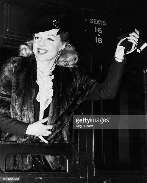 Actress Barbara Perry waving a glove as she arrives at Waterloo Station London August 3rd 1951