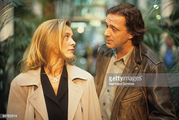 """Actress Barbara Rudnik acts with actor Gerd Silberbauer at the set of the ZDF Movie """"Im Atem der Berge"""" on October 14, 1997 in Munich, Germany"""