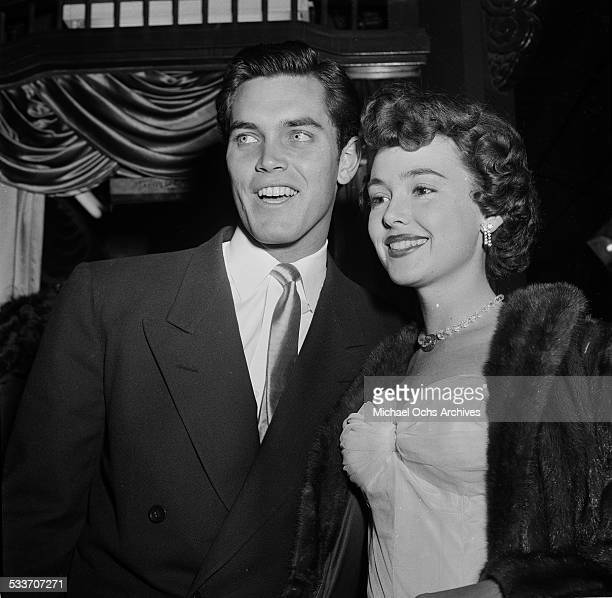 Actress Barbara Rush and husband Jeffrey Hunter attend a movie premiere in Los AngelesCA