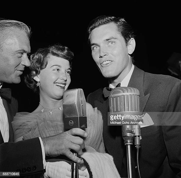 Actress Barbara Rush and husband Jeffrey Hunter attend a movie premiere of The Robe in Los AngelesCA