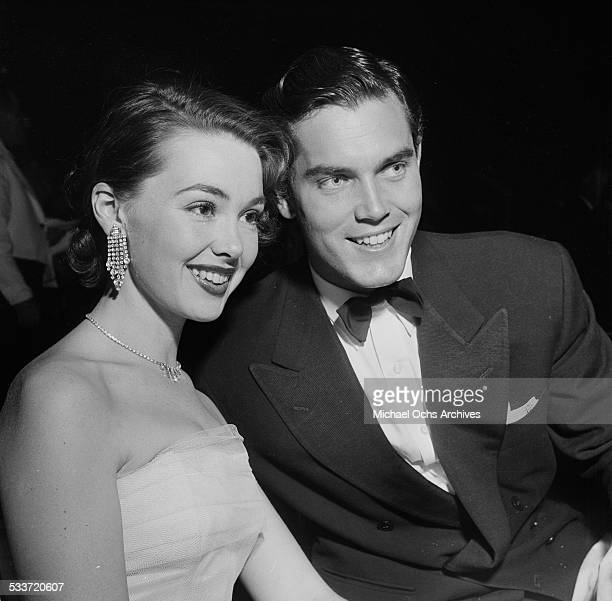 Actress Barbara Rush and husband Jeffrey Hunter attend a movie premiere of Prince Valiant at Romanoff's in Los AngelesCA