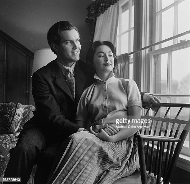 Actress Barbara Rush and husband Jeffrey Hunter pose at home in Los AngelesCA