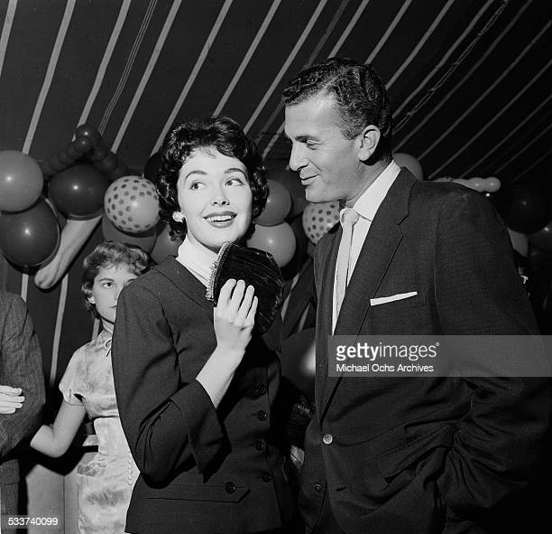 Actress Barbara Rush attends Mike Todds party with a guest in Los AngelesCA