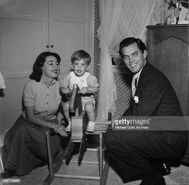 Actress Barbara Rush husband Jeffrey Hunter and son Christopher pose at home in Los AngelesCA