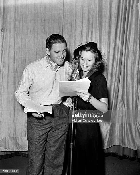 Actress Barbara Stanwyck and actor Errol Flynn record a script at the CBS Studios in Los Angeles California