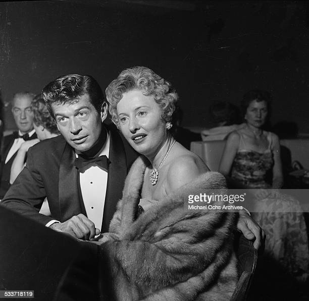 Actress Barbara Stanwyck and actor George Nader attend the International Press Club Awards in Los AngelesCA