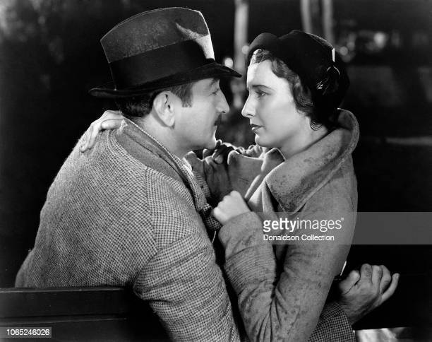Actress Barbara Stanwyck and Adolphe Menjou in a scene from the movie Forbidden