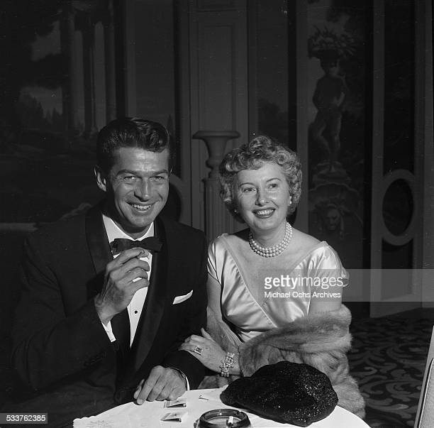 Actress Barbara Stanwyck and George Nader attend the Screen Producers Awards in Los AngelesCA