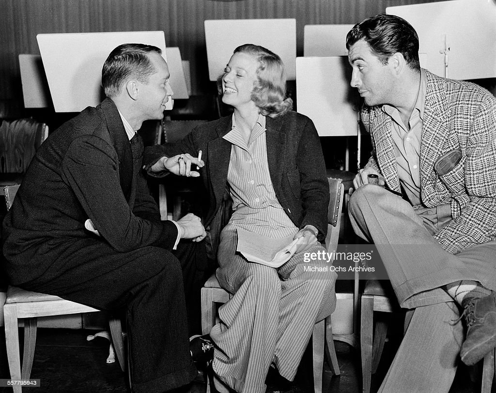 Actress Barbara Stanwyck and husband actor Robert Taylor (R) with actor Franchot Tone on the set of 'Three Comrades' in Los Angeles, California.