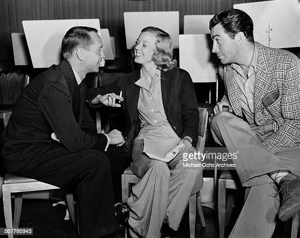 Actress Barbara Stanwyck and husband actor Robert Taylor with actor Franchot Tone on the set of 'Three Comrades' in Los Angeles California