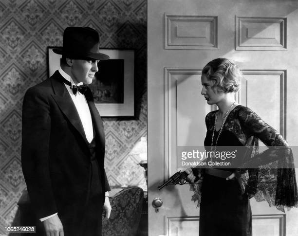 Actress Barbara Stanwyck and Ralph Bellamy in a scene from the movie Forbidden