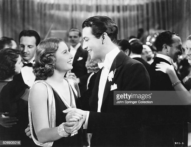 Actress Barbara Stanwyck as Rita Wilson Claybourne and actor Robert Talor as Chris Claybourne dance in a scene from the 1936 drama My Brother's Wife...