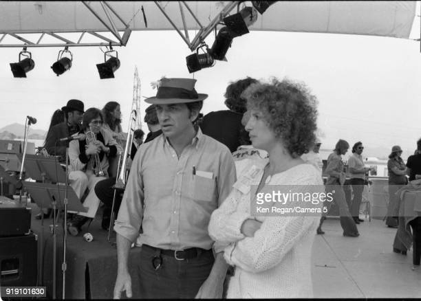 Actress Barbara Steisand and Bill Graham are photographed on the set of 'A Star is Born' in 1976 at Sun Devil Stadium in Tempe Arizona CREDIT MUST...
