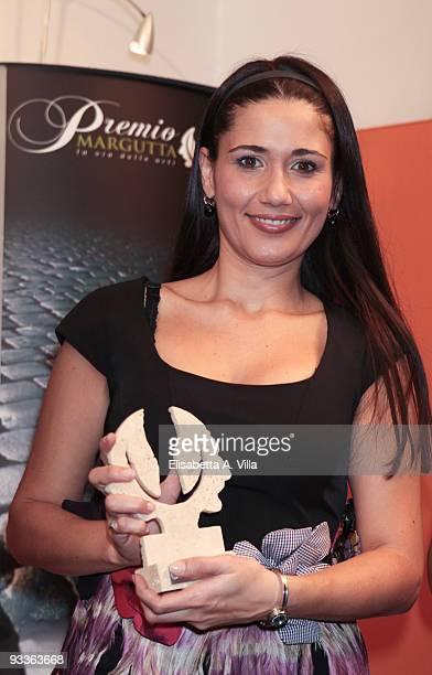 Actress Barbara Tabita shows her award during the '2009 Margutta Awards' at Margutta RistorArte on November 24 2009 in Rome Italy