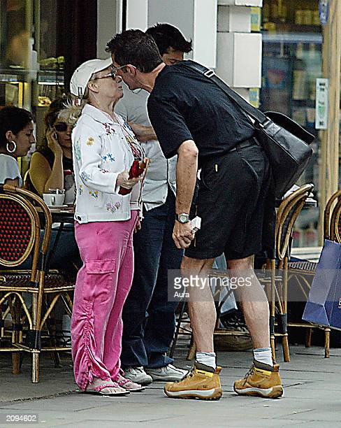 Actress Barbara Windsor and her husband Scott Mitchell eating together with television presenter Dale Winton June 19 2003 in Central London