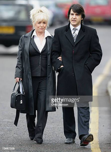 Actress Barbara Windsor and husband Scott Mitchell attend the funeral of actor John Inman at Golders Green Crematorium on March 23 2007 in London...