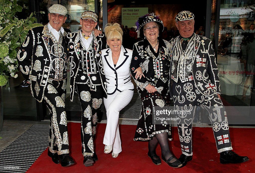 Actress Barbara Windsor dances with pearly kings and queens as she attends The Galleries of Modern London launch party at the Museum of London on May 27, 2010 in London, England.