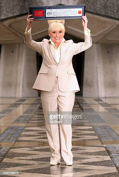 Actress Barbara Windsor poses for photographs after receiving the Freedom of the City of London at the Guildhall on August 4 2010 in London England...