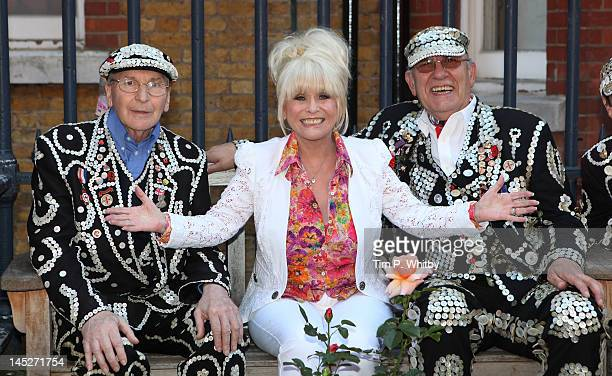 Actress Barbara Windsor poses 'pearly kings' while launching the appeal to save the gardens at St Paul's parish church Covent Garden on May 25 2012...