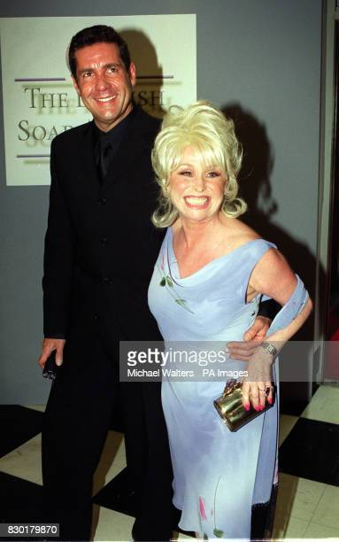 Actress Barbara Windsor, who won Best Actress for her role as Peggy Mitchell in the soap Eastenders, with television presenter Dale Winton at the...