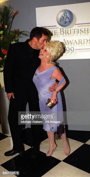 Actress Barbara Windsor, who won Best Actress for her role as Peggy Mitchell in the soap Eastenders, gets a kiss from Dale Winton at the British Soap...