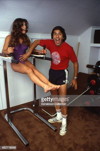 Actress Barbi Benton poses for a portrait session while working out with her husband George Gradow at home in circa 1979 in Los Angeles California