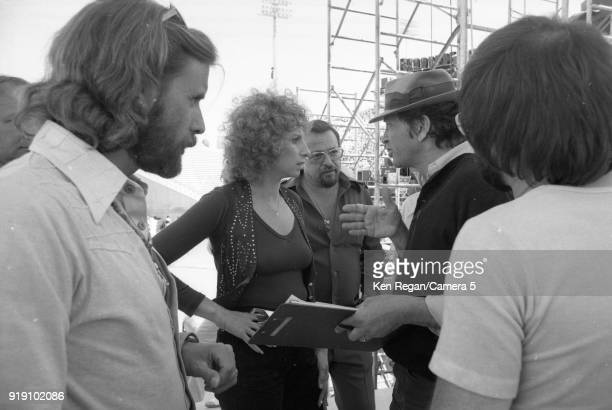 Actress Barbra Streisand and Bill Graham are photographed on the set of 'A Star is Born' in 1976 at Sun Devil Stadium in Tempe Arizona CREDIT MUST...
