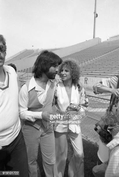 Actress Barbra Streisand and producer Jon Peters are photographed on the set of 'A Star is Born' in 1976 at Sun Devil Stadium in Tempe Arizona CREDIT...