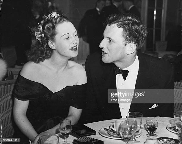 Actress Beatrice Campbell and producer Sam Goldwyn Jnr sitting together at a supper party following the premiere of the film 'The Best Years of Our...