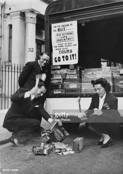 Actress Bebe Daniels and her husband actor Ben Lyon break open a box of batteries which can be reused for industrial purposes 7th September 1940