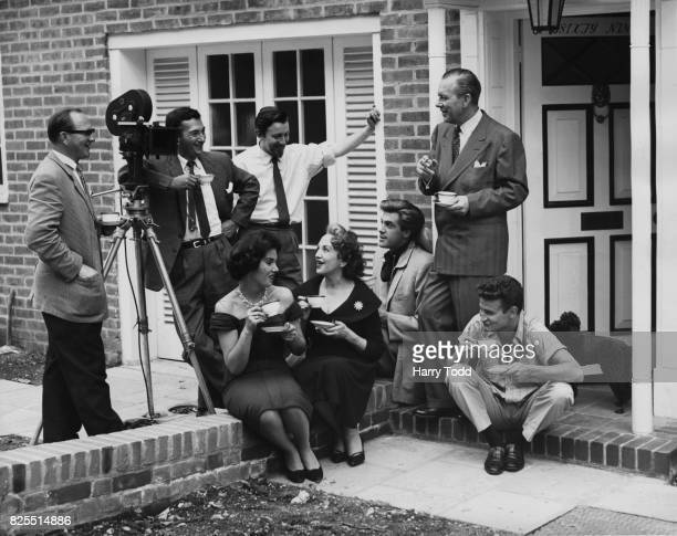 Actress Bebe Daniels and her husband actor Ben Lyon with their children Richard and Barbara on the steps of their new home in Abbotsbury Road West...