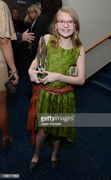 Actress Bebe Wood holds the award for Favorite New TV Comedy backstage at the 39th Annual People's Choice Awards at Nokia Theatre LA Live on January...
