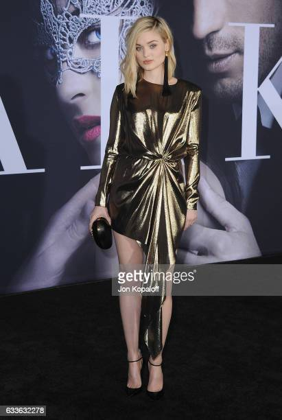 Actress Bella Heathcote arrives at the Los Angeles premiere Fifty Shades Darker at The Theatre at Ace Hotel on February 2 2017 in Los Angeles...
