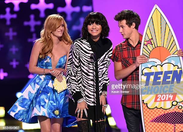 Actress Bella Thorne actress Zendaya and internet personality Cameron Dallas onstage during FOX's 2014 Teen Choice Awards at The Shrine Auditorium on...